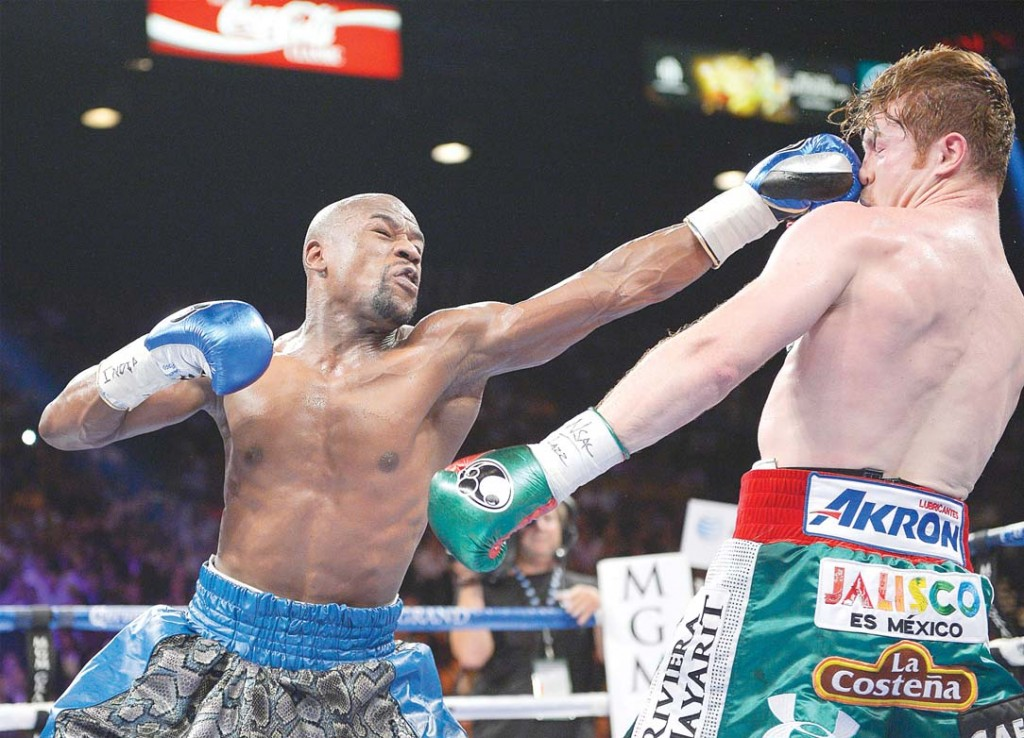 Floyd Mayweather lands a jab en-route to taking a lopsided decision from Canelo Alvarez Saturday night.