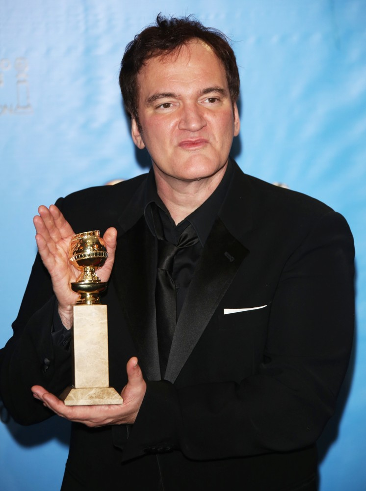 Quentin Tarantino displaying his Former Great Directors award.