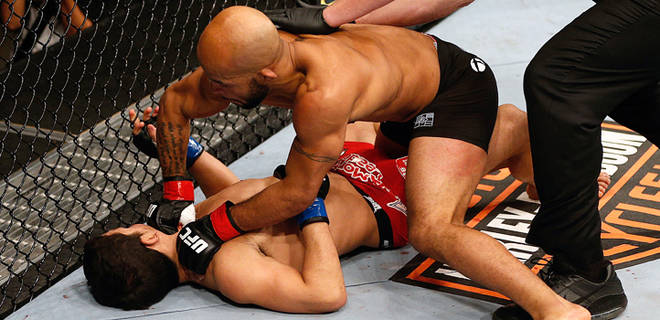 """Demetrious """"Mighty Mouse"""" Johnson retained his UFC bantamweight title with a stunning first-round KO over Joseph Benavidez Saturday night."""