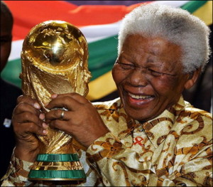 Nelson Mandela happily accepting his Stupidest Shirt of the Year award.