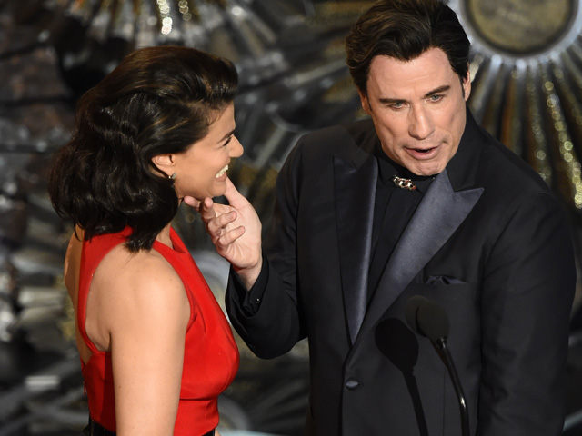 """What is this strange creature called a female?"" Travolta's skins is so waxy he looks like Data from Star Trek."