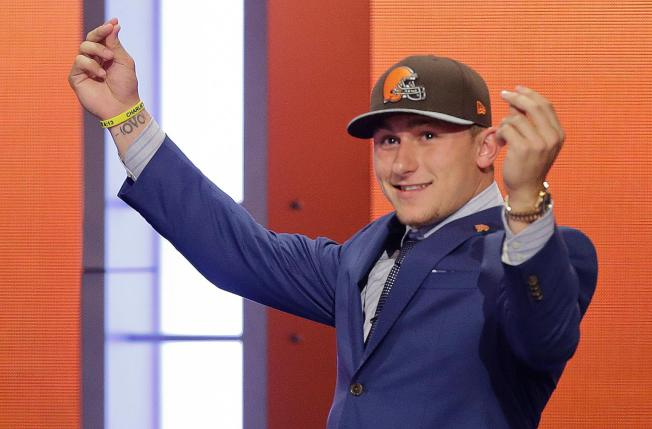 """Here's another one of Cleveland's finest hours. Unfortunately, they didn't realize this wasn't Manziel's """"money"""" sign as much as it was his titty-twirling technique at strip clubs."""