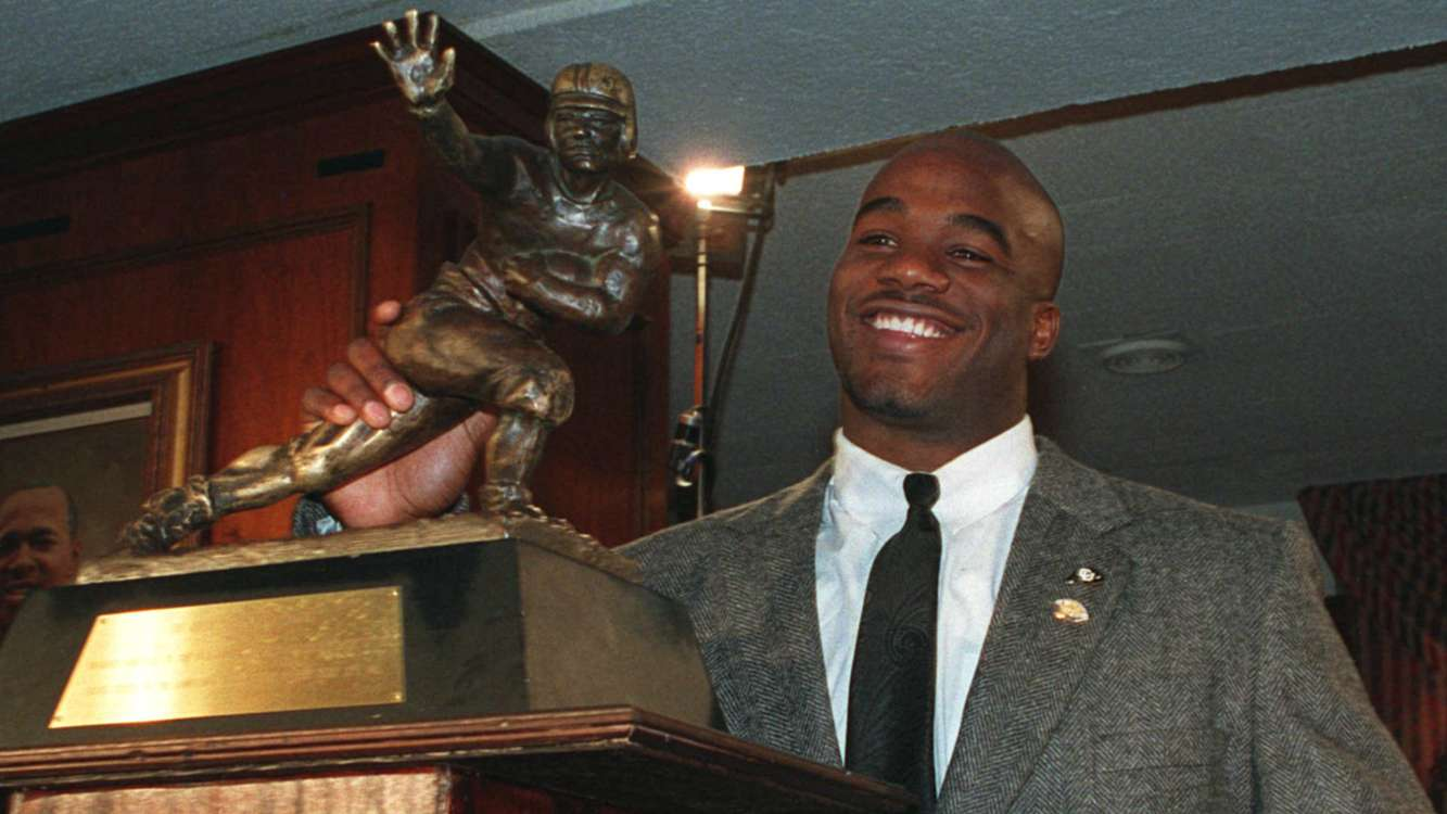 """Salaam was overjoyed about his Heisman accomplishment, telling reporters, """"I damn near had to kill myself to get this thing."""""""