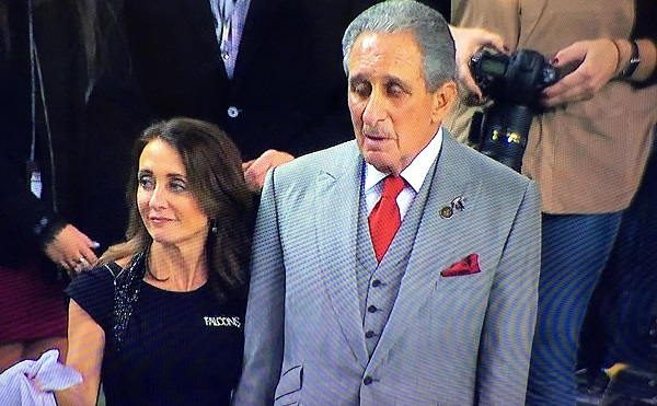 Here's Falcons owner Arthur Blank watching his historic Super Bowl defeat with his great granddaughter. Wait? That's his goddam wife? Well, you've got to respect a girl so obviously dedicated to true love.