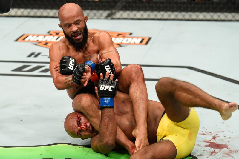 Flyweight champ Demetrious Johnson defending his belt for the tenth time, securing a third round armbar victory over Wilson Reis.