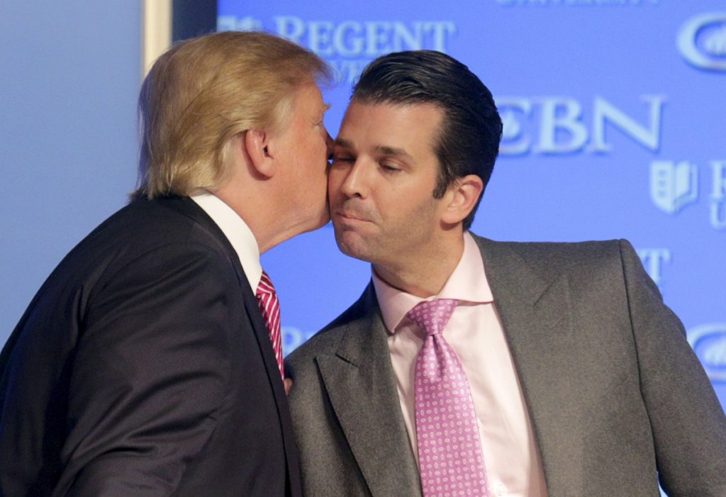 The most hideous make-out session in presidential history. Pretty soon they'll be swapping spit through prison glass.